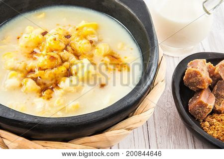 Traditional Colombian corn mazamorra served in black ceramic dish