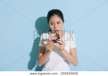 Confused Unhappy Lady Standing On Blue Background