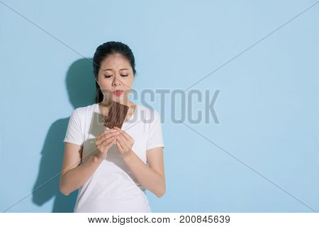 Attractive Girl Standing On Blue Wall Background