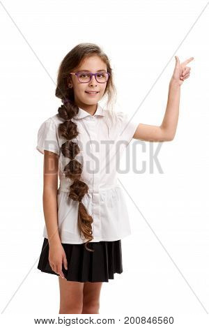 Side view portrait of young schoolgirl showing direction with finger