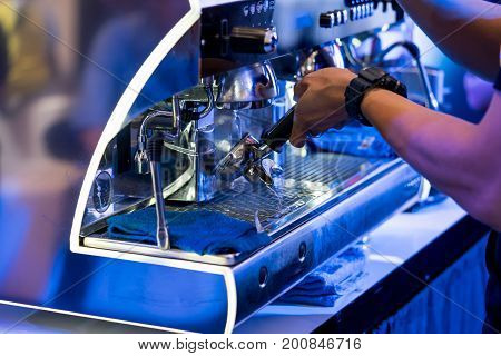 Close Up Of Barista Cleaning Coffee Machine