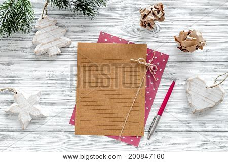 Plan for the year 2018. Sheet of paper and christmas decoration on grey wooden background top view.