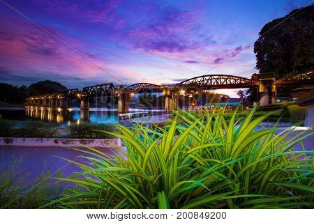 colorful twilight time of river khaw bridge in kanchanaburi most popular world war II history traveling destination in western of thailand