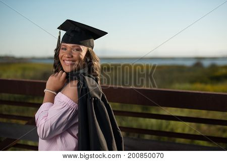 Young lady in cap an gown ready for graduation
