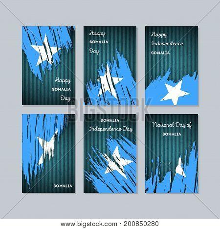 Somalia Patriotic Cards For National Day. Expressive Brush Stroke In National Flag Colors On Dark St