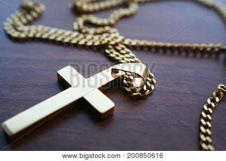 Golden Catholic Cross On Table High Quality