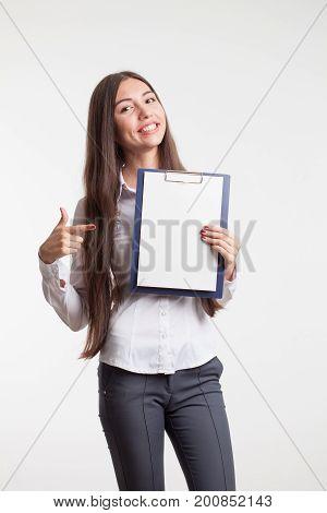Beautiful woman wearing formal wear. Secretary with clipboard. poster
