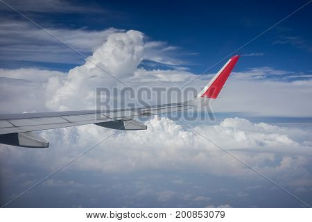 Kuala Lumpur Malaysia - 19th August 2017 : Shot of a tip of Air Asia plane traveling through beautiful clouds in good weather condition.