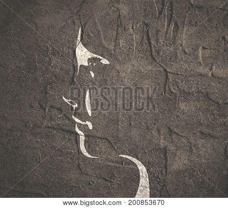 Face side view. Elegant silhouette of a female head. Monochrome gamma. Grunge distress texture.