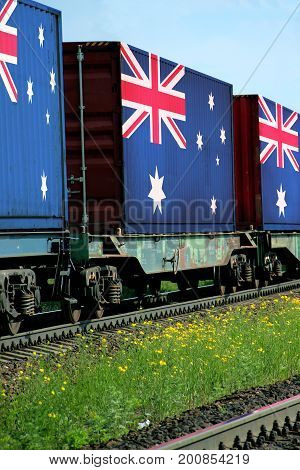 Train Freight transportation. Cargo transit. Summer Day. Container textured by flag of the Australia