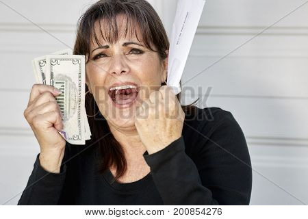 Worried Woman Holding Bills Due And Currency