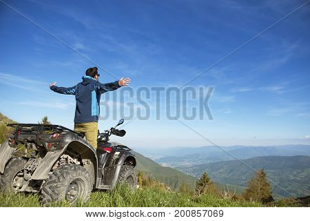 Man on the ATV Quad Bike on the mountains road