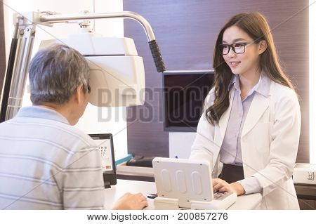 old man with optometrist in the store