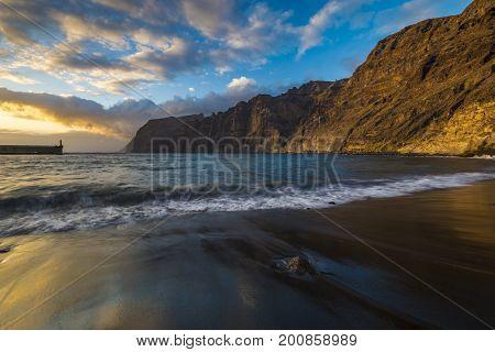 Sunset over Los Gigantes beach in Tenerife