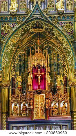 AMSTERDAM, NETHERLANDS - MARCH 30, 2017  Altar Wooden Church Figures Crucifix Angels De Krijtberg Church Amsterdam Holland Netherlands. De Krijtberg may be the most beautiful church in Amsterdam.