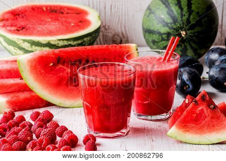 healthy drinks. watermelon and raspberry smoothies on white wooden background.