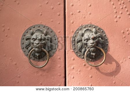 Door with lions. Old Chinese metal door with lions handles