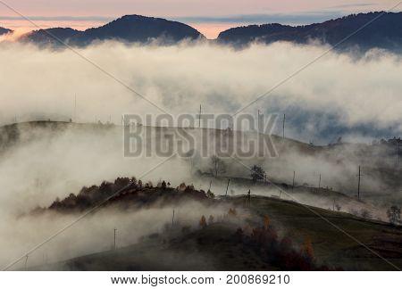Fog Above The Rural Hills At Dawn