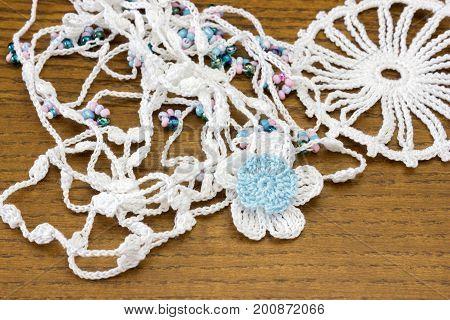 Handmade crochet white chain and a blue flower. Homemade necklace, needlecraft