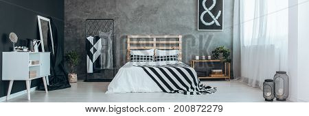Stylish Bedroom With Clothes Rack