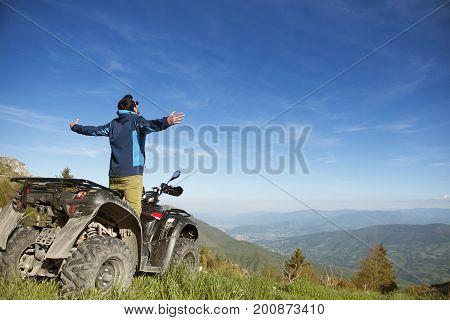 Man on the ATV Quad Bike on the mountains road