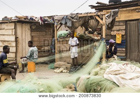 Accra Ghana - December 28 2016: Fishermen check their nets in Jamestown fishing port area in Accra.