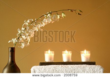White Towels With Candles And Flowers