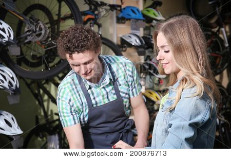 Young couple in bicycle shop