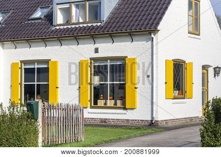 Holland house with bright colourful windows in Holland