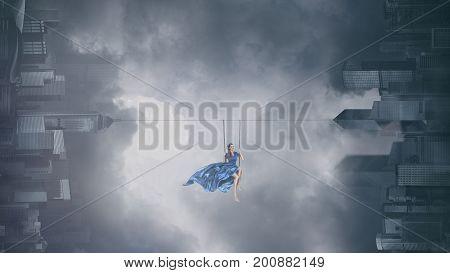 Fashion Woman On Swing Above City