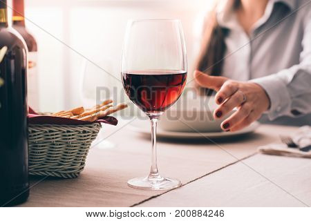 Woman Tasting Wine And Having Lunch