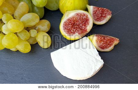 Group Of Fresh Figs, Goat Cheese And Green Grapes