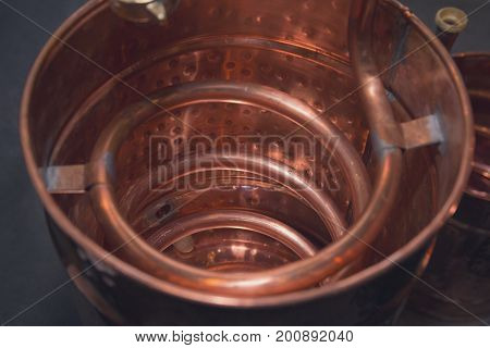 Copper alcohol mashine close up. Alcohol industry