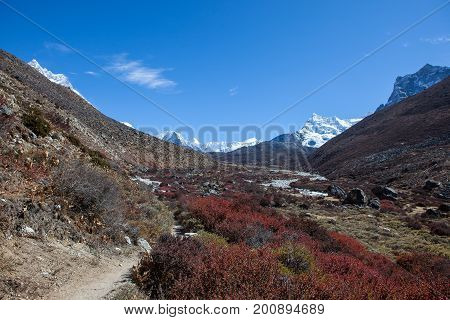 Beautiful Himalayan Landscape With Mountain Range On The Horizon And Barberry Shrubs In The Valley O