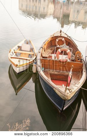 Vintage fishing boats in Vieux Bassin, old port of Honfleur in Normandy region of France