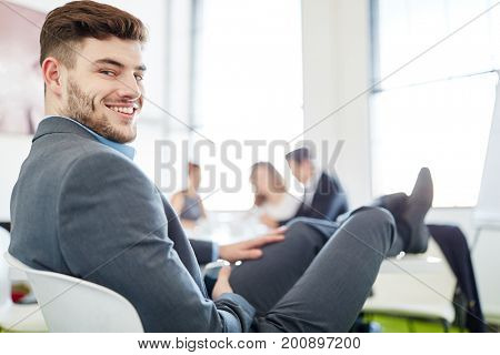 Businessman taking a break with feet up