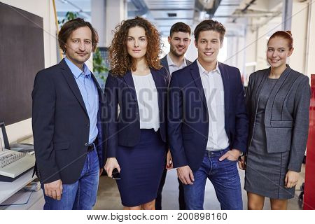 Portrait of competent business team  in office