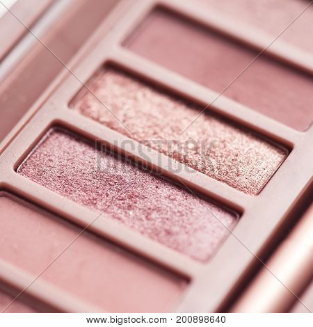 Used eye shadow palette with rose gold colors closeup. Makeup product. Selective focus.