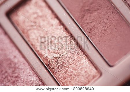 Rose gold eye shadow closeup. Selective focus.