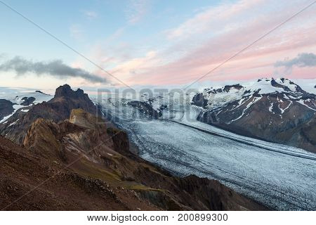 Glacier River Going Down The Volcano Mountain On Sunset. Kristinartindar Mountain In Southern Icelan