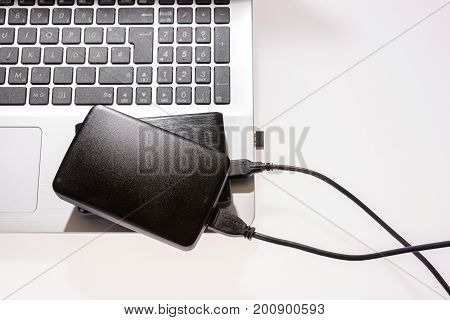 Two external or portable hard drive (HDD) connected to laptop