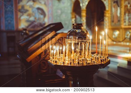 ambiance of church candles and bokeh yellow lights