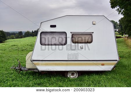 Old-fashioned 1980s Belgian brand mini caravan on a camping site in Belgium.