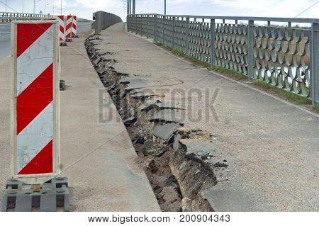 repair broken sidewalk pavement cracks equipment cracks