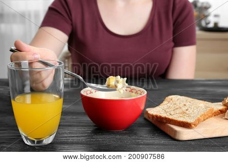 Woman eating tasty lunch and drinking fresh juice
