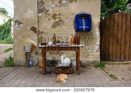 SUZDAL/ RUSSIA - AUGUST 19, 2017. Street vendor counter with bottles of Mead, jars with jam and ups of berries in the historical center of Suzdal, Vladimir region, Russia.