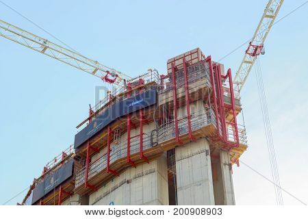 London UK - May 24 2017 - Construction site of Newfoundland a residential development in Canary Wharf with crane on sky background