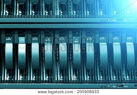 Row of hard disks close-up. The concept of information technology .