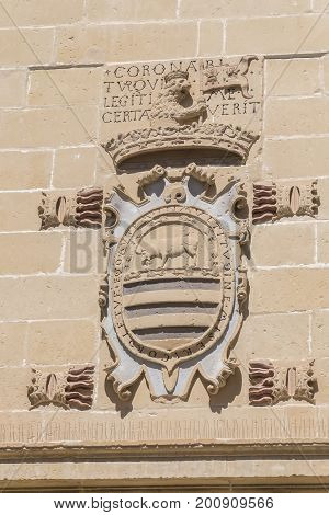 Old justice house and jail facade detail now City Hall Baeza Spain
