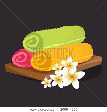 three colored rolled folded fluffy terry towels isolated Decorated with lilies, on black background. vector illustration
